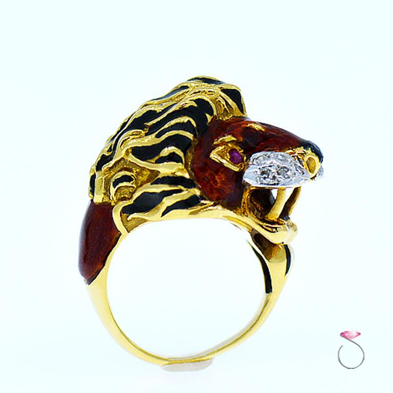 Rare Vintage enamel large Lion ring from the 1960's. This gorgeous figural ring features a beautifully enameled Lion in vibrant reddish Brown & Black enamel, the Lion's tail loops around the finger and settles next to the head.  The Lion has Ruby