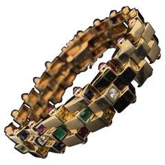 Vintage Diamond, Sapphire, Emerald Ruby Bracelet 18 Karat Yellow Gold Circa 1960