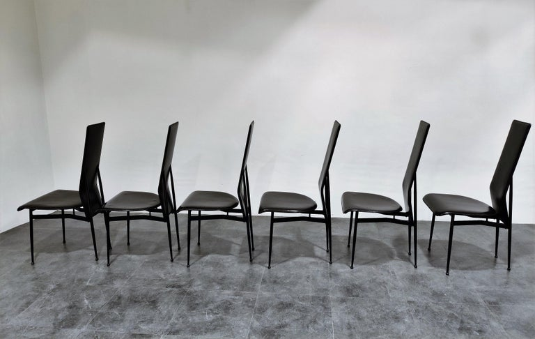 Set of 6 leather dining chairs designed by Giancarlo Vegni for Fasem italy.  The chair seat well, are beautifully designed and made from quality materials.  Notice the beautiful legs.  The chairs are in very good condition with minimal