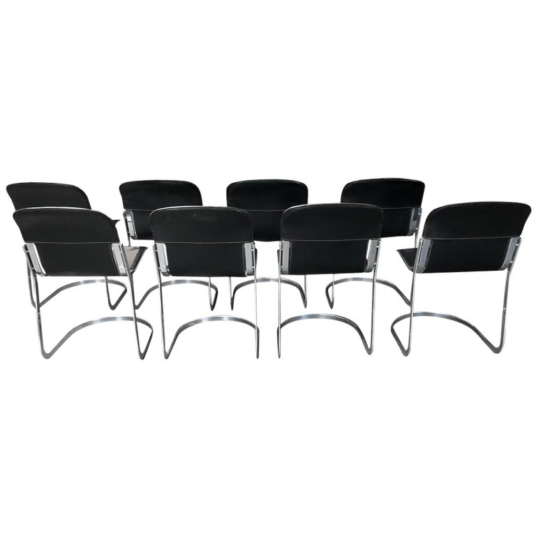 Set of 8 dining chairs designed by Willy Rizzo for Cidue (model C2).  The chairs have a beautifully shaped chrome frame and come with the original black leather seats.  The chairs are stackable.  Very good condition, no discoloration, no