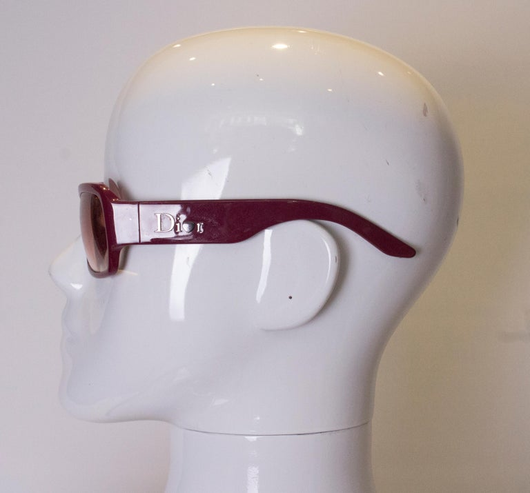 A pair of vintage Dior sunglasses  in a stunning purple colour. The glasses were made in Italy.