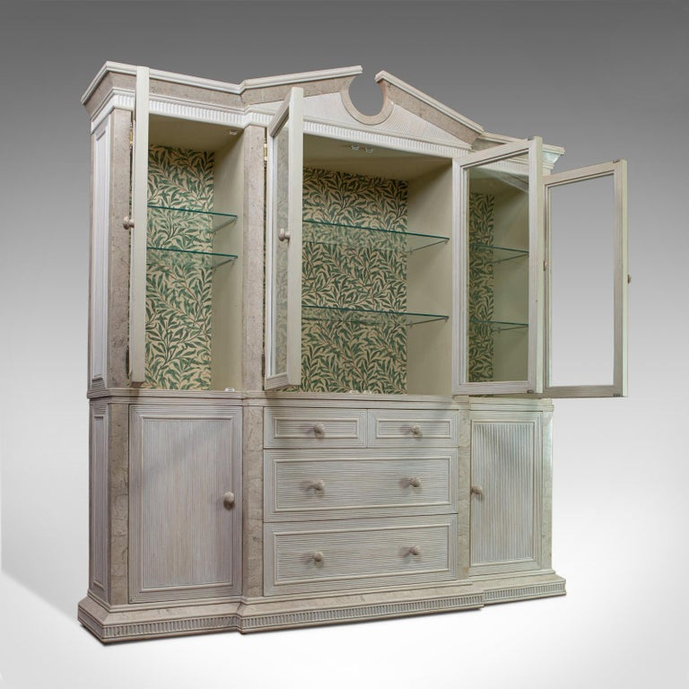 This is a vintage display cabinet. An English, beech and travertine, breakfront cabinet in the classical taste and dating to the late 20th century, circa 1980.  Eye-catching cabinet in generous proportion Good consistent color