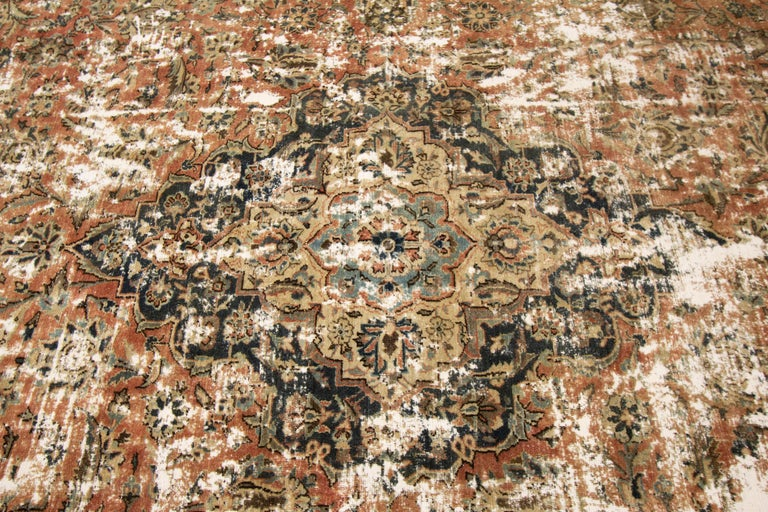 20th Century Vintage Distressed Hand Knotted Wool Rug For Sale