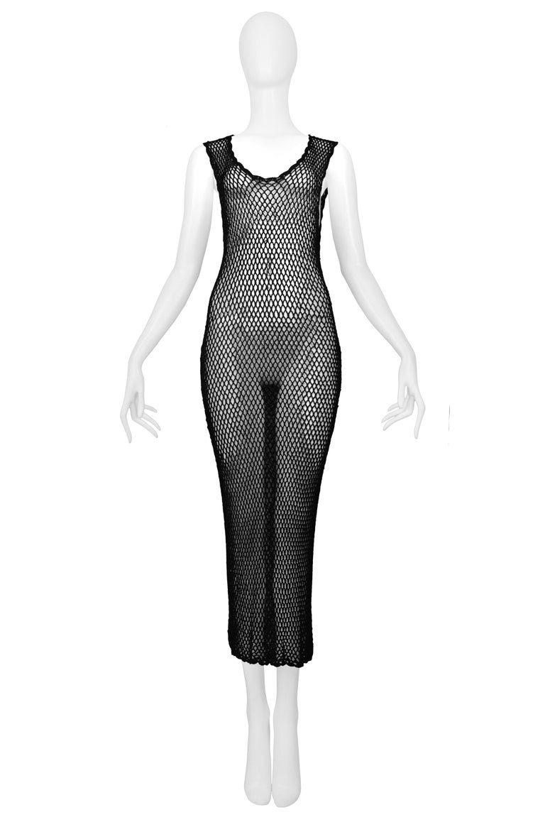 Resurrection Vintage is excited to offer a vintage Dolce & Gabbana black fishnet dress with a scoop neckline, scalloped edges, and keyhole back.   Dolce & Gabbana Size Medium / Unmarked Measurements (Approx) Bust: 25-56