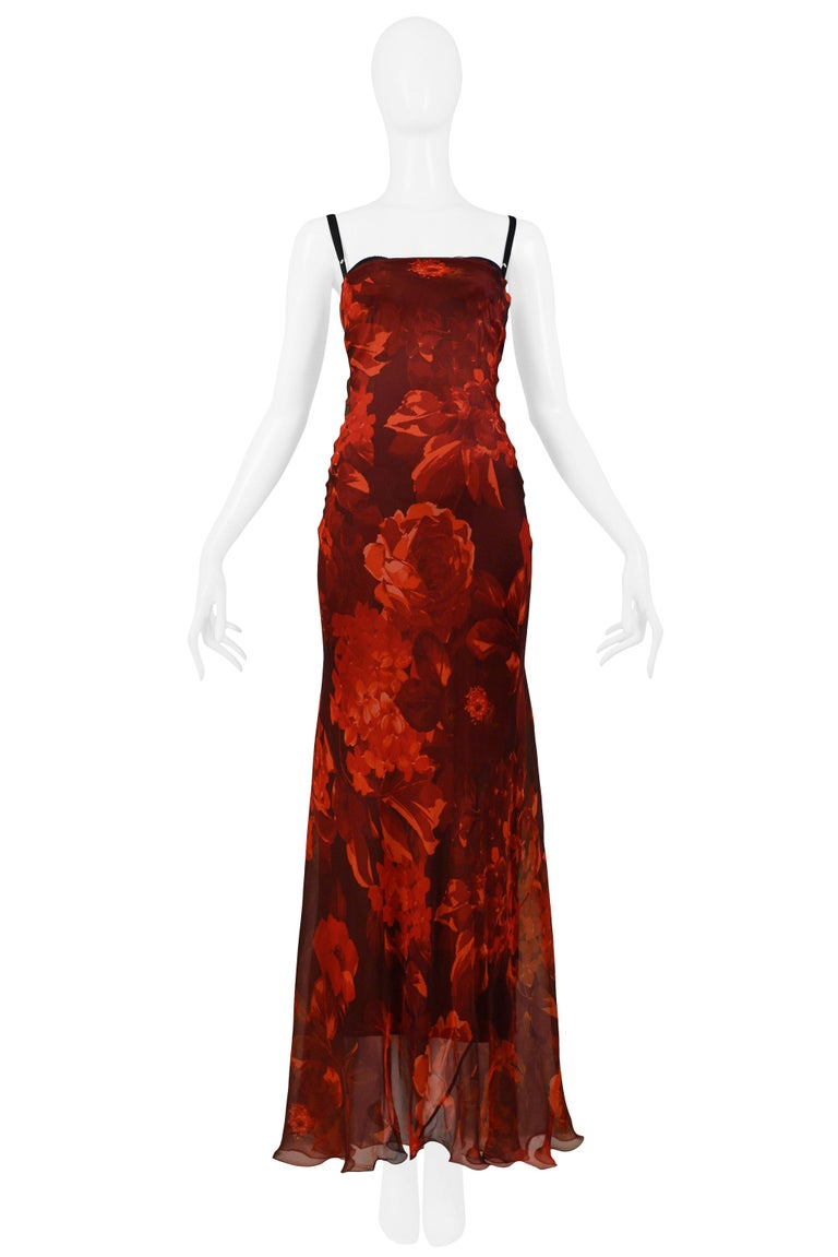 We are pleased to offer this vintage Dolce & Gabbana red floral silk chiffon evening gown with black underdress with built in-bra, adjustable straps, center back zipper, and slight mermaid silhouette.  Dolce & Gabbana Size 40 Silk Excellent Vintage