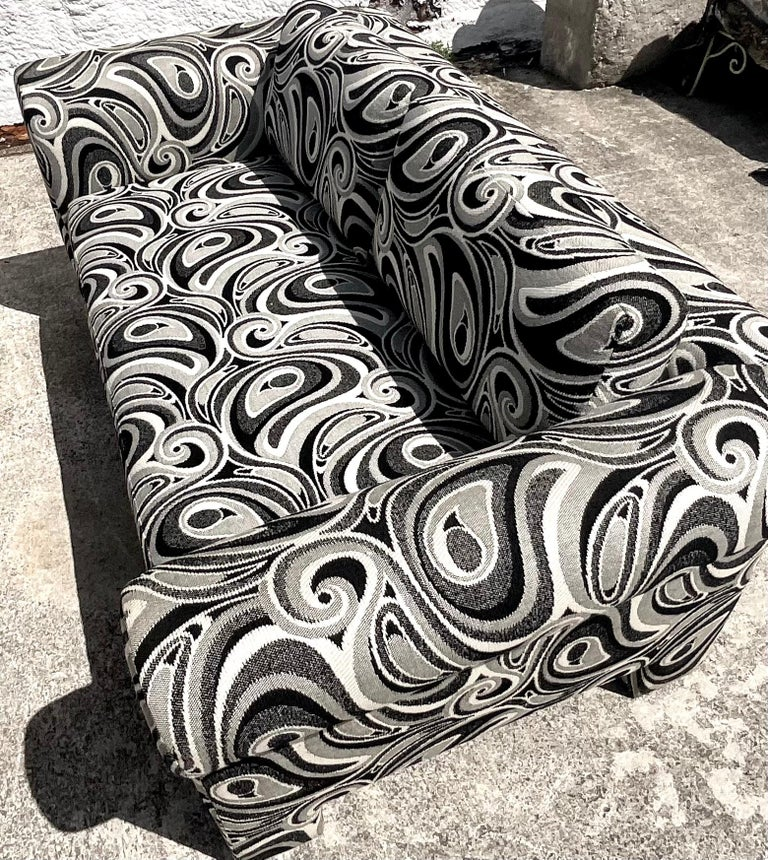 Fantastic pair of vintage Dreyfuss loveseats. A chic black and white swirl jacquard. Done in the manner of Milo Baughman. Acquired from a Palm Beach estate.