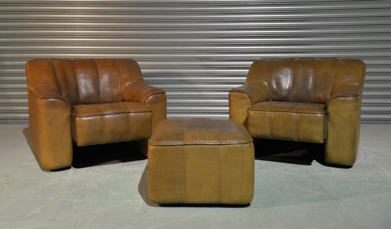 Discounted airfreight for our US and International customers (from 2 weeks door to door)  We are delighted to bring to you a pair of vintage 1970s De Sede DS 44 armchairs and matching ottoman in thick buffalo leather. These vintage armchairs and