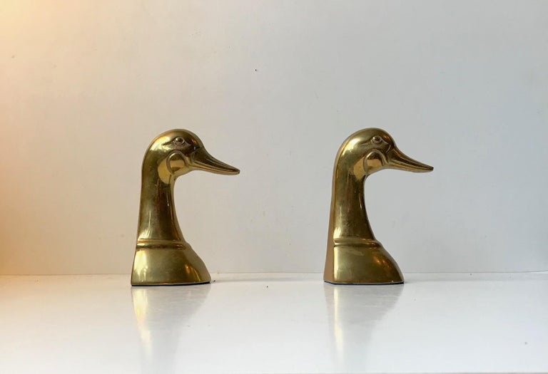 - A pair of vintage cast brass and hand-finished duck bookends