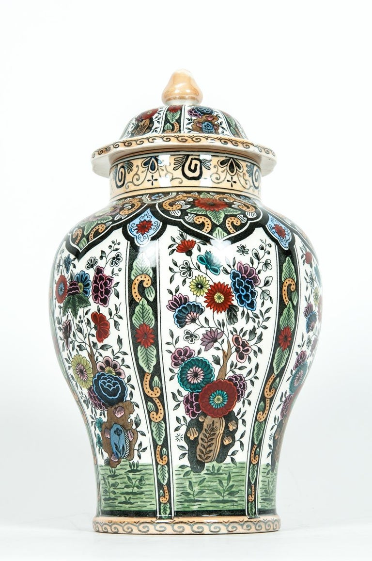 Vintage Dutch porcelain decorative covered urn. The covered urn is in excellent condition, maker's mark undersigned. The piece measure about 11.5 inches high X 8 inches diameter.