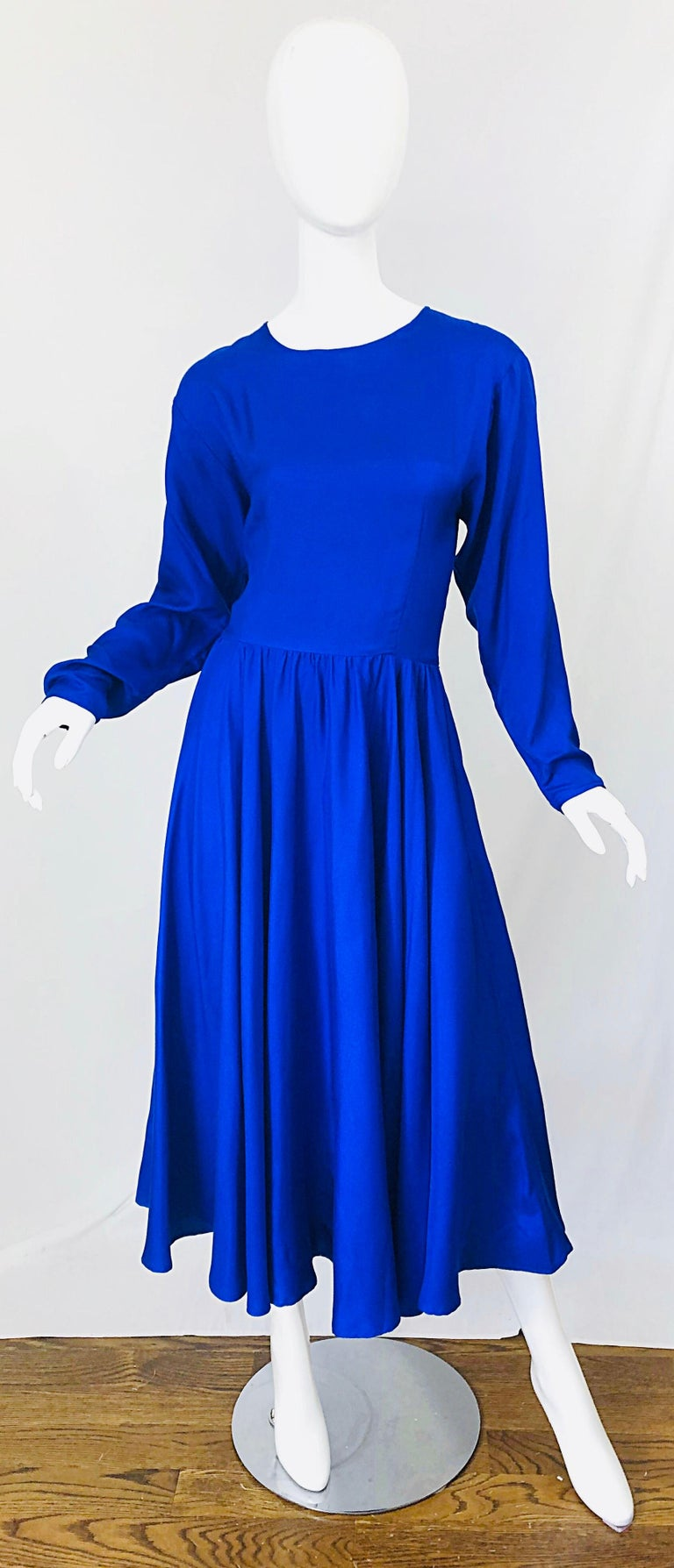 Beautiful DYNASTY royal blue late 1970s silk long dolman sleeve midi dress! Features a slight dolman sleeve that began to trend in the late 70s and early 80s. Beautiful and flattering fit, with so much attention to details. Hidden zipper up the back