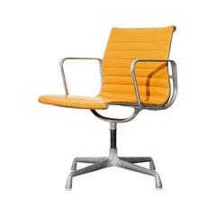 Vintage Eames Aluminum Group Chair in Orange Naugahyde