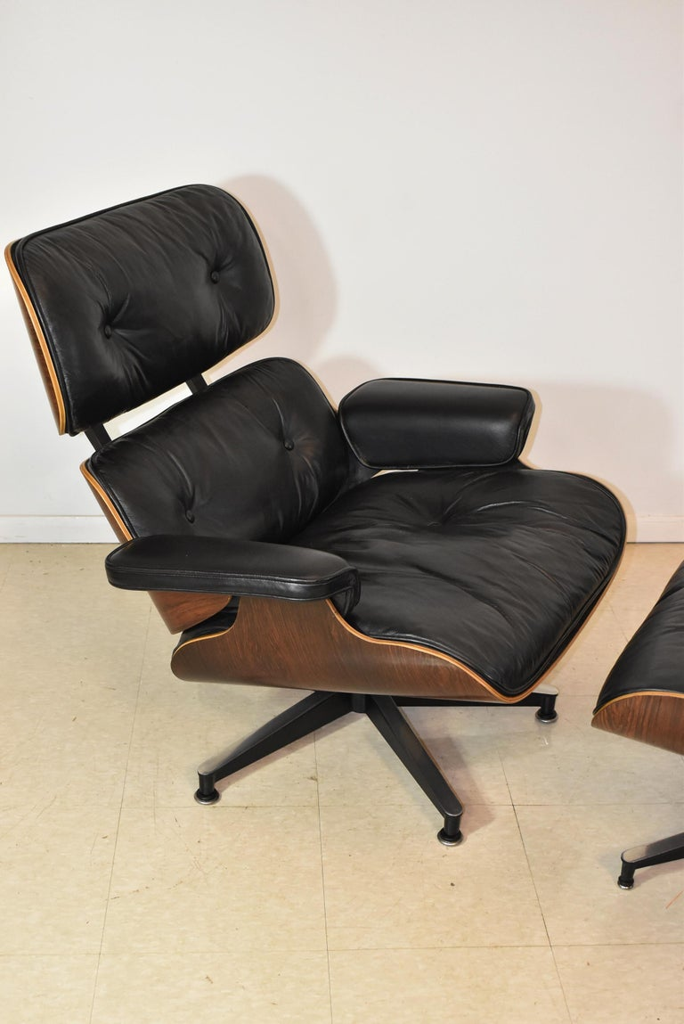 Modern Vintage Eames Black Leather and Rosewood Chair and Ottoman