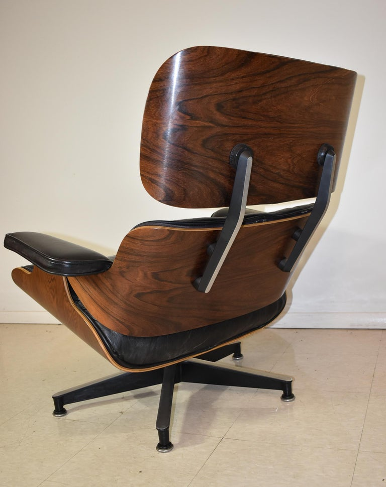 20th Century Vintage Eames Black Leather and Rosewood Chair and Ottoman