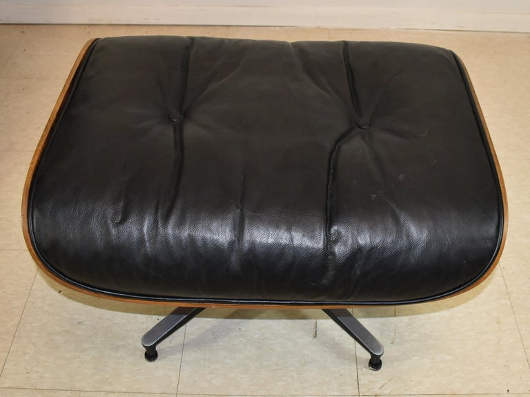 Vintage Eames Black Leather and Rosewood Chair and Ottoman 1