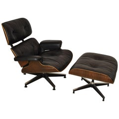 Vintage Eames Black Leather and Rosewood Chair and Ottoman