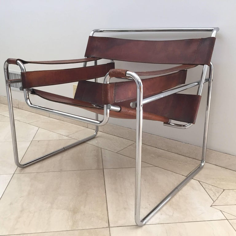 All original Marcel Breuer Wassily chair for Knoll in brown leather straps and tubular frame.