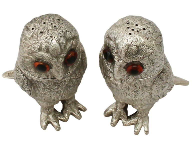 An exceptional, fine and impressive pair of vintage English cast sterling silver pepperettes or peppers modelled in the form of owls; an addition to our collectable silver collection  These exceptional vintage Elizabeth II cast sterling silver