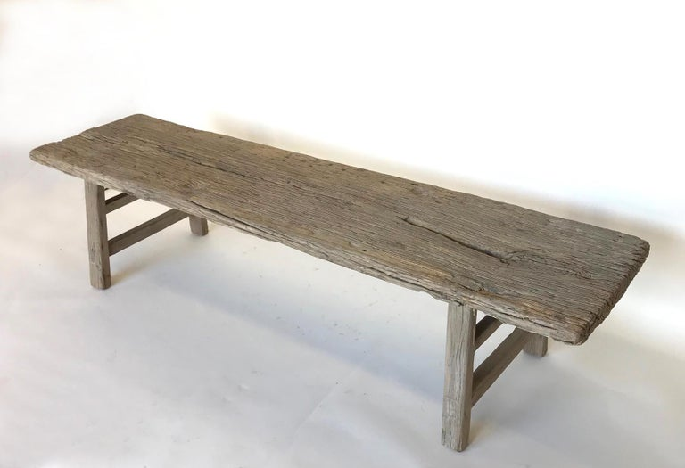 Vintage elm bench with great, weathered patina. Mortise and Tenon construction, double side stretchers. Can work as a bench, low console or coffee table.