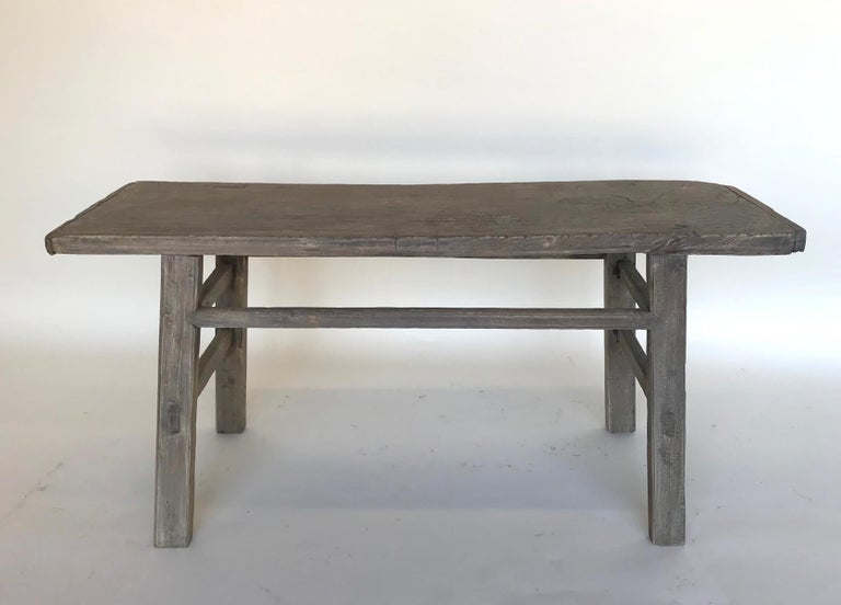 Short vintage elm bench with mortise and tenon construction and double side stretchers. Lovely weathered smooth patina.