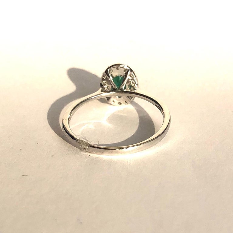 Modern Vintage Emerald and Diamond 18 Carat White Gold Cluster Ring For Sale