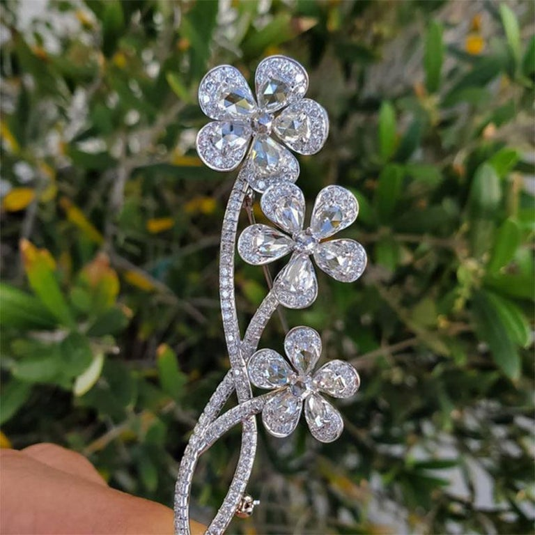 Vintage, En tremblant, 18 karat white gold rose cut diamond flower brooch. This is one of the most beautiful and well made pins. It's made for both women and men. The petals in the flowers are rose cut diamonds that are white in color and eye clean.