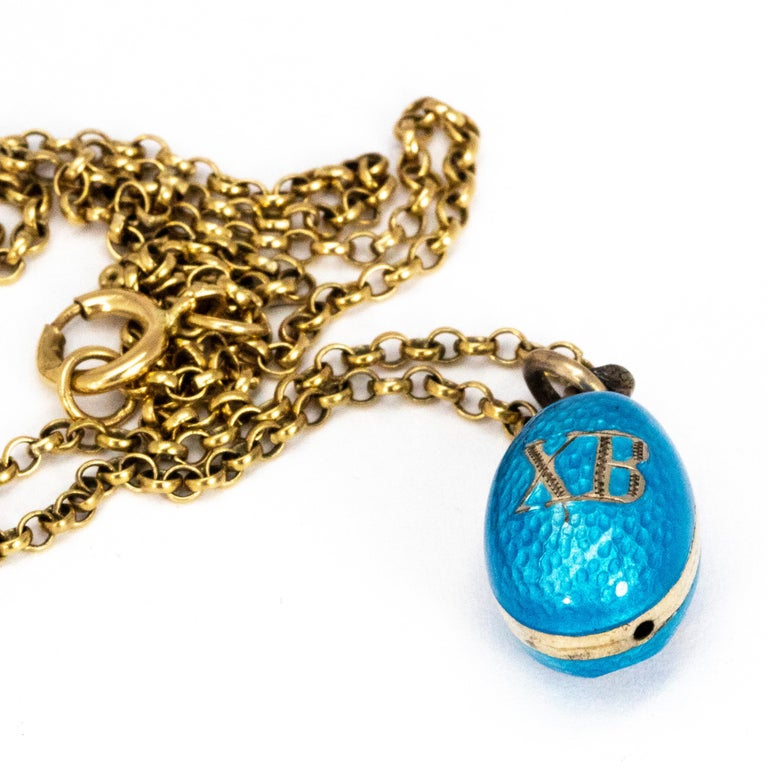 Threaded onto this necklace is the sweetest egg pendant. The egg is covered in pale blue enamel and on one side of the egg there is a flower decorated with seed pearls and the other side has XB. The XB motif stands for Christos Anesti, or Christ is