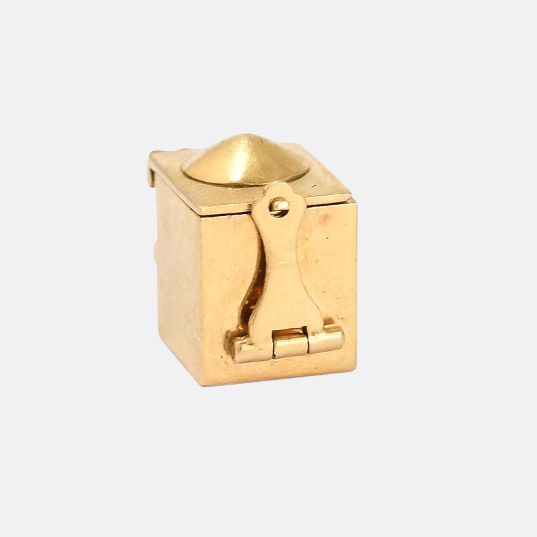 A cool vintage jack-in-the-box charm dating from 1969. The jack is enamelled, and spring-loaded so it pops up when the catch is released... Modelled in 9 karat gold.  MEASUREMENTS  Height: 1.2cm  WEIGHT  3.8g  MARKS English hallmarks for 9k gold,