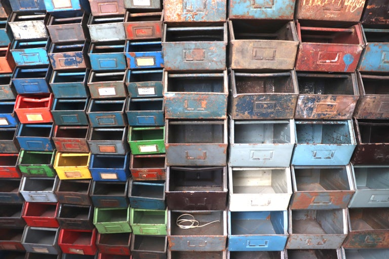 Amazing multi-color enameled metal stacking utility bins in original condition with visible patina and wear in varying conditions of use.