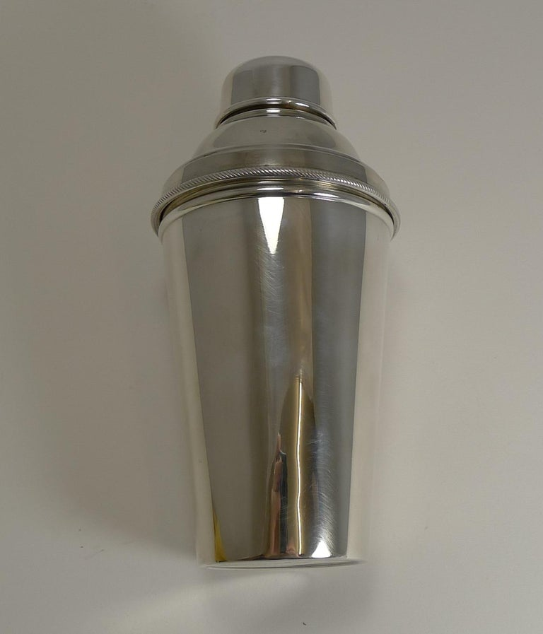 A wonderful one pint Cocktail Shaker in silverplate. Highly desirable, this one has an integral ice breaker which is revealed once the upper portion is removed.  The underside is signed by the well renowned silversmith, James Dixon and Sons and