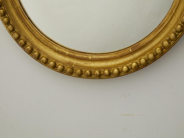 Carved Vintage English Midcentury Giltwood Convex Mirror with Beaded Motifs For Sale