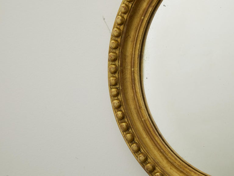 20th Century Vintage English Midcentury Giltwood Convex Mirror with Beaded Motifs For Sale