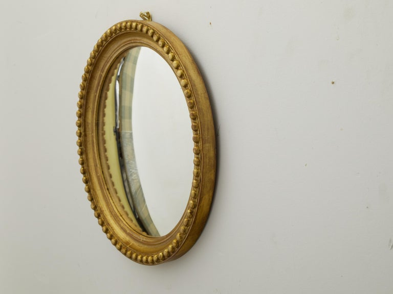 Vintage English Midcentury Giltwood Convex Mirror with Beaded Motifs For Sale 1