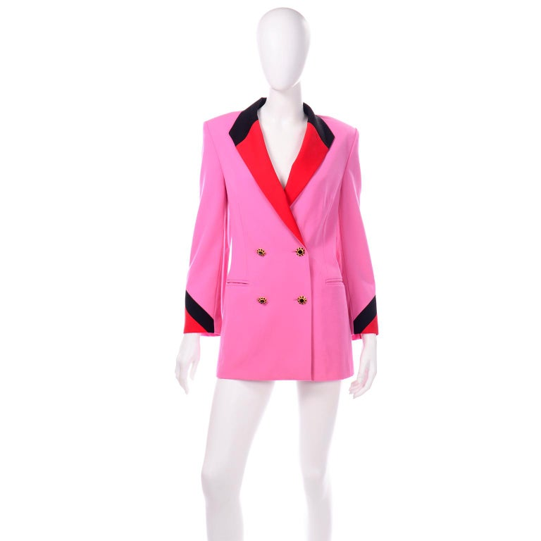 This vibrant 1980's Margaretha Ley Escada blazer is in a gorgeous pink Summer weight wool with red and black accent colors on the collar and cuffs. This longline double breasted blazer has unique gold and black rhinestone buttons on the front. The