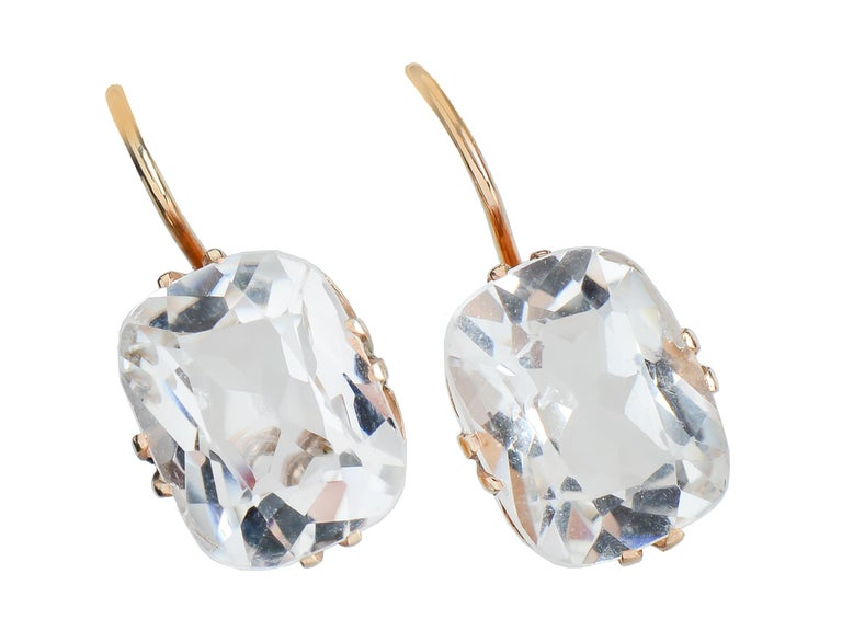 Brilliant 8 Ct. rock crystal earrings, set in 14 Kt gold, dress up an outfit whether it be denim or evening wear. The crystal is cool, pure and gives a lift to one's spirit.  Many sense that crystal has healing and calming properties.  The earrings