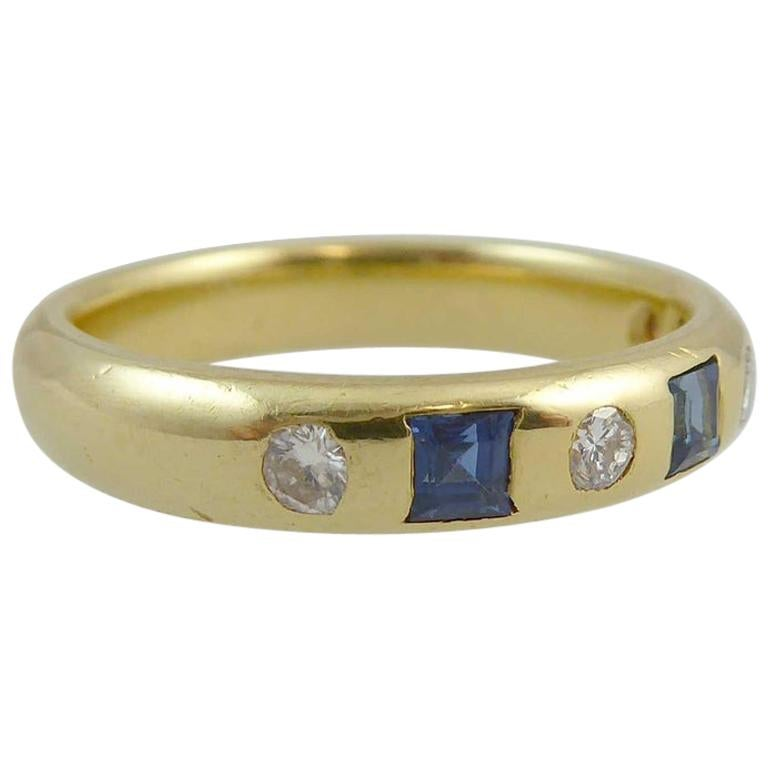 Vintage Eternity Ring Set with Sapphires and Diamonds in a Yellow Gold Band