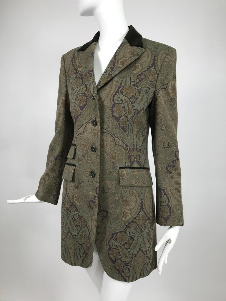 Vintage Etro paisley fine wool riding jacket from the 1990s. Etro, the company that was built on the paisley and is known for beautiful design with a bohemian flair. This gorgeous jacket is perfect for any occasion from casual dressy. The design in