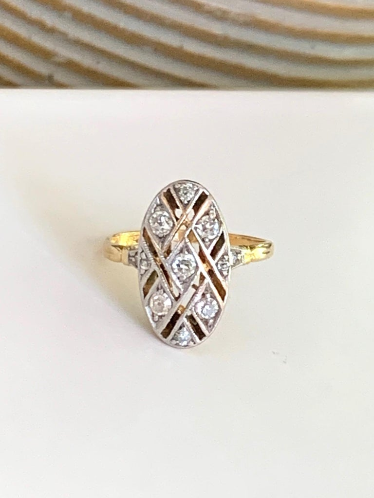 This vintage ring is stunning with the open weave-work around each of the 11 Euro cut Diamonds.  The Diamonds total approximately .30ctw with an average grade of SI-H.  Size: 5 - this ring is resizable but G. Lindberg Jewels does not provide sizing