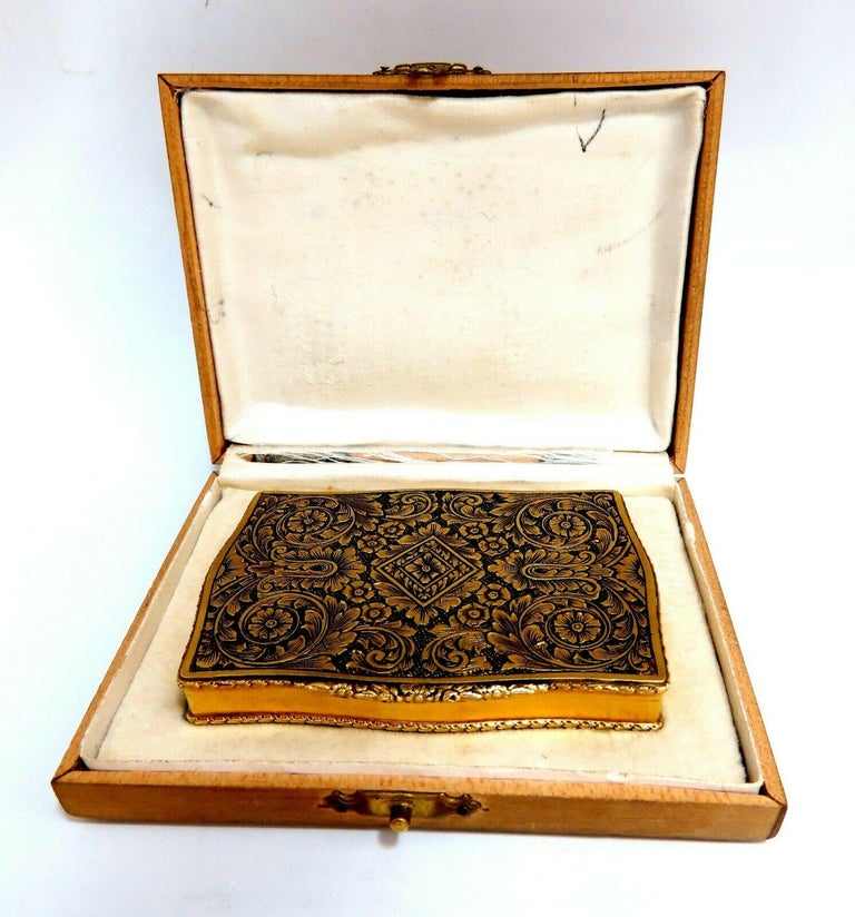 Antique 18kt European Gold Box  3 x 2.1 inch  Depth: .44 inch  18Kt Yellow Gold  Grand Weight: 91.6 Grams  Includes original outer box.  Intricate graver - engraving details.