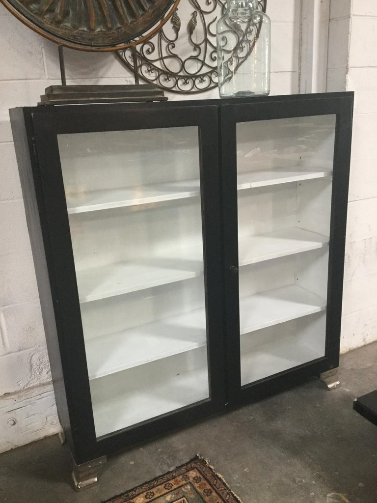 A beautiful vintage black and white cabinet. Simple and great for any space.