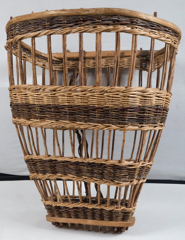 Vintage European field basket, 20th century. Woven wicker and wood. Used for hand-harvesting and designed to be worn on back.