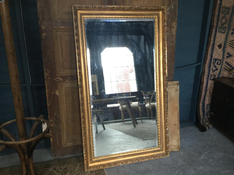 Vintage European gilded mirror with fine detailing. This neoclassical mirror is a beautiful accent in any type of space.