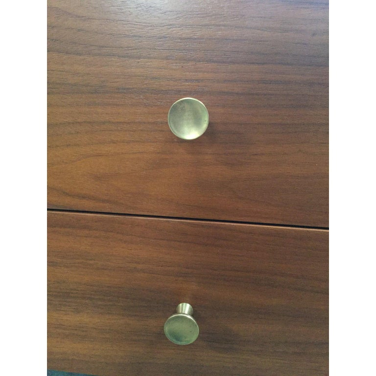 Beautiful midcentury nightstands. Featuring tapered legs and golden knobs.