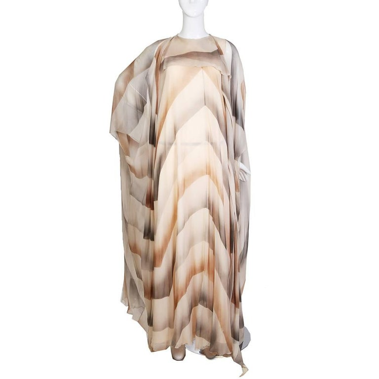 Vintage caftan by unknown designer Sheer silk with grey and beige large scale chevron gradient pattern Nude lining underneath Top hook and eye in the back Condition: Great Size/Measurements: 42