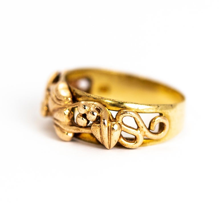 This fancy gold band has two tone gold berry and vine detail that is wrapped around half of the band. The band underneath the vines is a split band. This would made the most perfect wedding band or a fancy everyday ring!  Ring Size: N or 6 3/4 Band