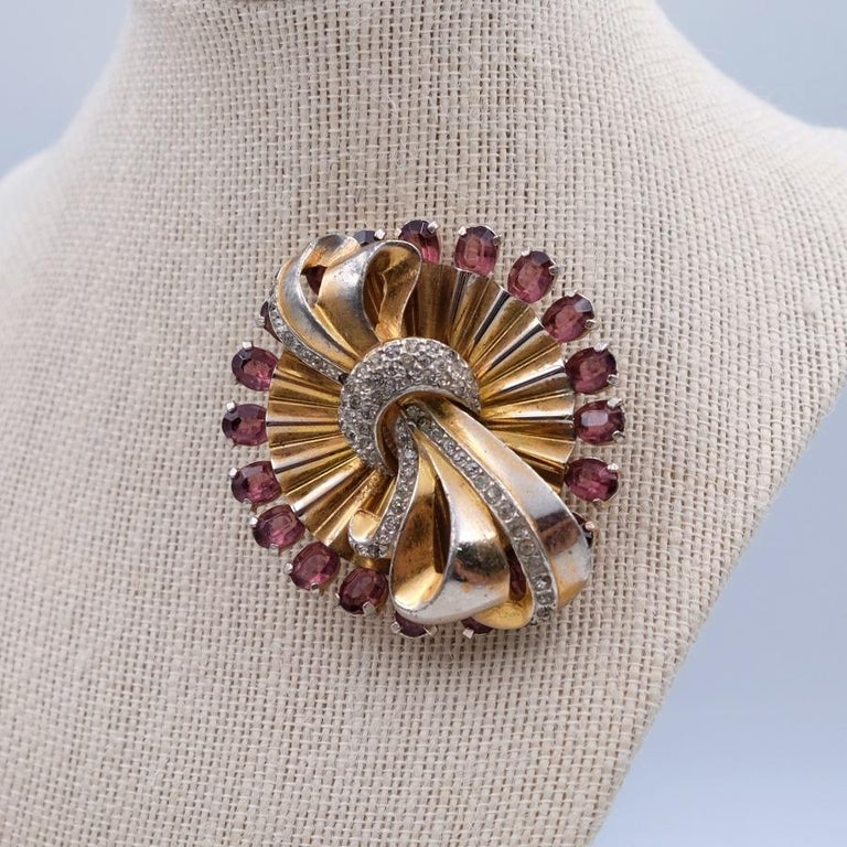 Year: 1940 Hallmark: - Dimensions: 2.63 in Materials: base metal, rhinestones, faux amethyst