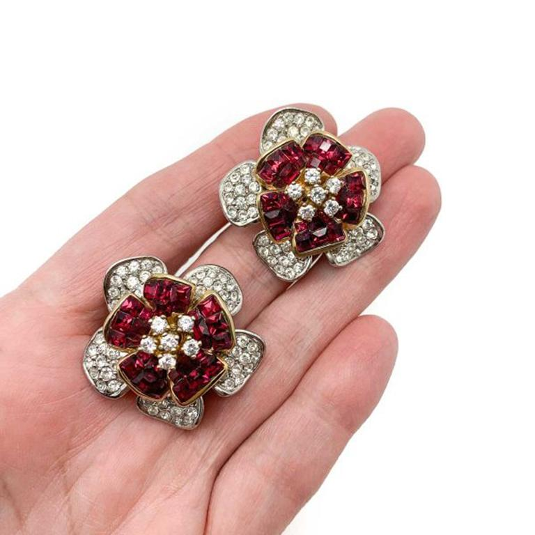 Vintage Ruby Crystal Flower Earrings. Stunning craftsmanship. Created in solid sterling silver and set with 'invisibly set' ruby and white crystals in a captivating floral design. Exceptional quality and attention to detail. Very good condition.