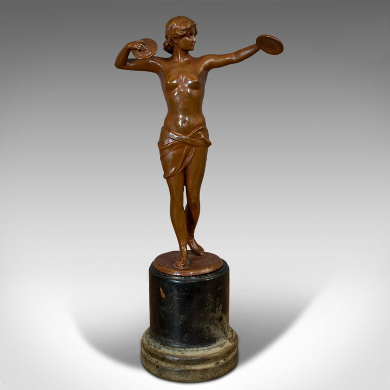 This is a vintage female figure. A French, bronze spelter Art Deco statuette, dating to the early 20th century, circa 1930.  Lithe gymnastic form Displays a desirable aged patina Bronze spelter in good order Rich caramel hues