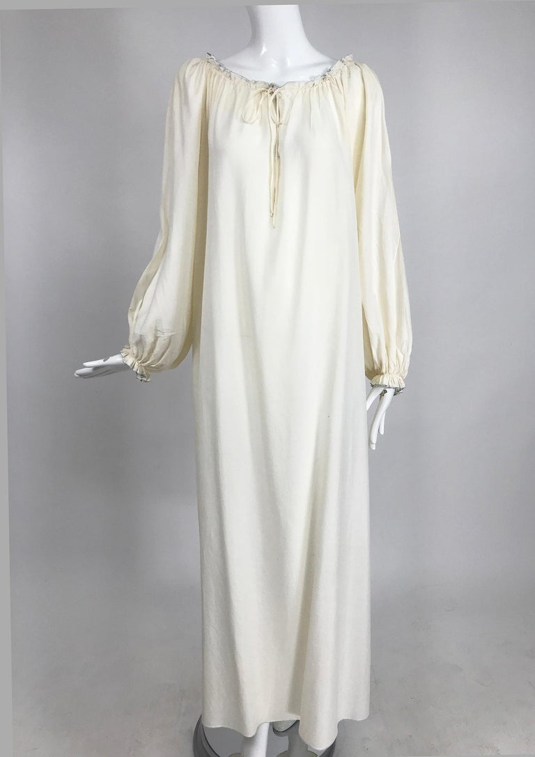 Vintage Fernando Sanchez cream silk bohemian maxi dress from the 1970s. Beautiful dress, the fabric is translucent, great worn with a belt (belt in photo, not included). Pull on dress has an open front drawstring gather, with center vent. Long full