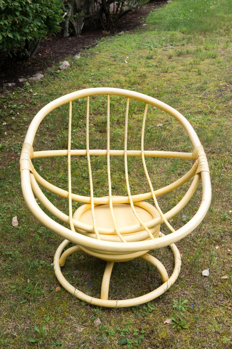 1970s vintage Ficks Reed yellow rattan or faux bamboo rocking chair with original yellow finish and fabric. Remarkably good condition. Cushion has stiffened with age.