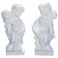 Figural Cast Iron Classical Cherub Garden Statues, Fall and Spring, 20th Century